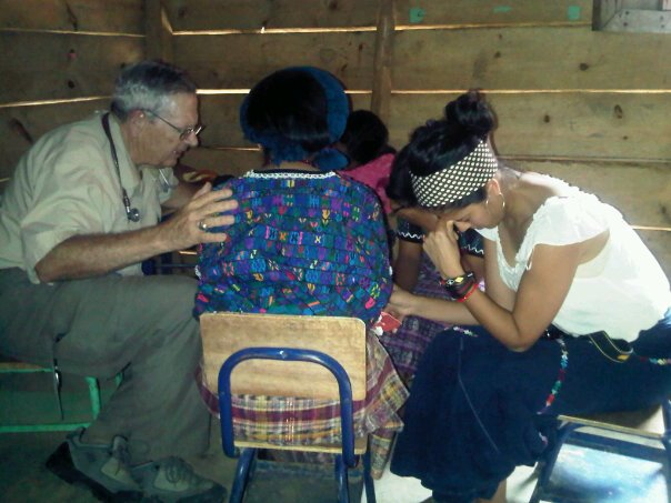 Dr. Brent and Tania praying over an Achi woman patient